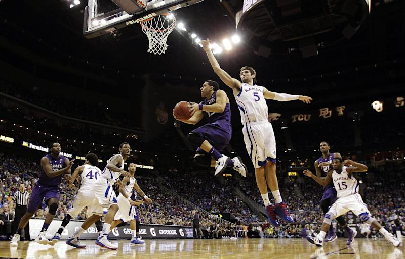 Kansas State guard Angel Rodriguez (13) shoots past Kansas center Jeff Withey (5) during the first half of the championship NCAA college basketball game of the Big 12 tournament, Saturday, March 16, 2013, in Kansas City, Mo. (AP Photo/Charlie Riedel)