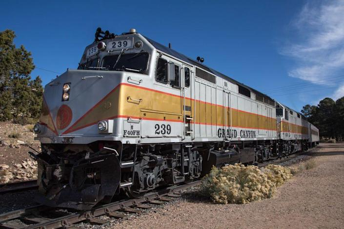 """<p>Departing daily from Williams, Arizona, the <a href=""""https://www.thetrain.com/"""" rel=""""nofollow noopener"""" target=""""_blank"""" data-ylk=""""slk:Grand Canyon National Railway"""" class=""""link rapid-noclick-resp"""">Grand Canyon National Railway</a> features western musicians, cowboy characters, and beautiful views before delivering you to the South Rim of Grand Canyon National Park. And because Grand Canyon Country features landscapes at varying elevations, you'll see a variety of different environments, from the Ponderosa pine forest that surrounds Williams to a wide-open prairie. </p>"""