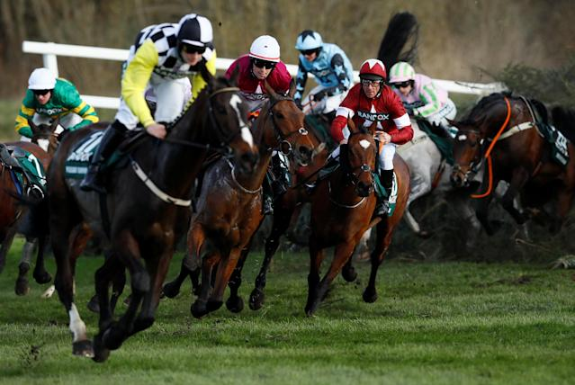 Horse Racing - Grand National Festival - Aintree Racecourse, Liverpool, Britain - April 14, 2018 Tiger Roll ridden by Davy Russell (R) in action at Canal Turn before winning the 17:15 Randox Health Grand National Handicap Chase Action Images via Reuters/Jason Cairnduff