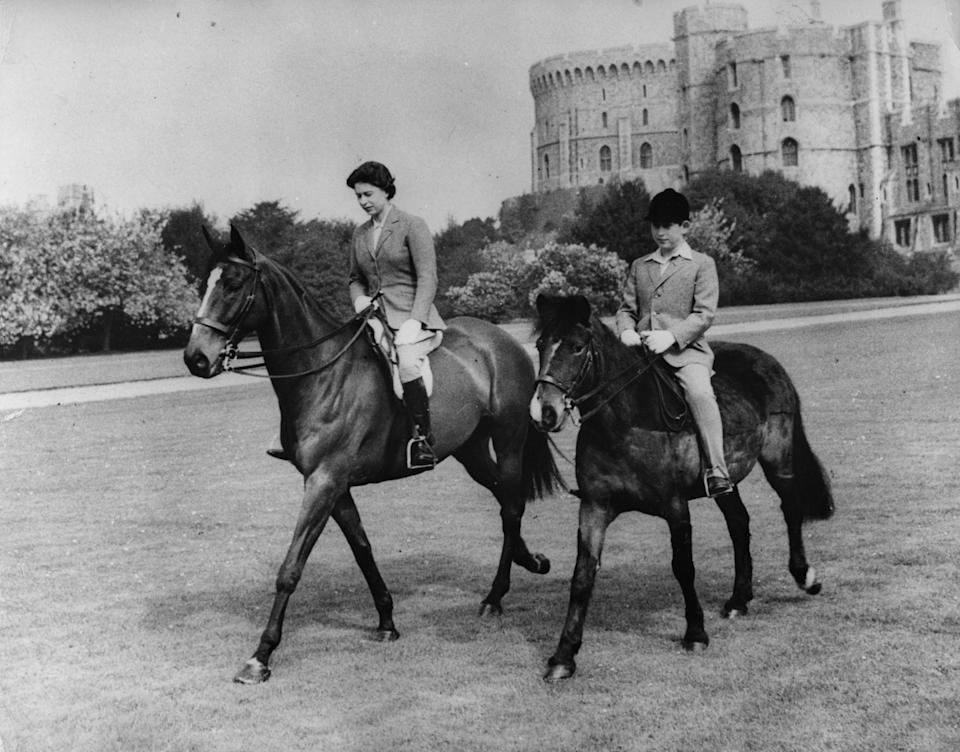 EMBARGOED TO 2230 SUNDAY MAY 31 File photo dated 18/5/1961 of Queen Elizabeth II and her son, Prince Charles, out riding at Windsor Castle. The Queen has been seen riding her horse this weekend in Windsor Home Park as she has been in residence at Windsor Castle during the coronavirus pandemic.