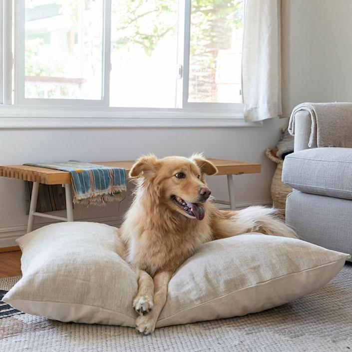 "$175, West Elm. <a href=""https://www.westelm.com/products/lcl-the-wolf-nest-linen-dog-bed-d7105/"" rel=""nofollow noopener"" target=""_blank"" data-ylk=""slk:Get it now!"" class=""link rapid-noclick-resp"">Get it now!</a>"