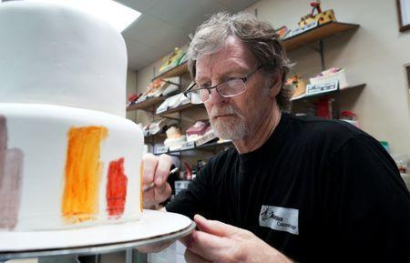 Baker Jack Phillips decorates a cake in his Masterpiece Cakeshop in Lakewood, Colorado U.S. September 21, 2017.REUTERS/Rick Wilking