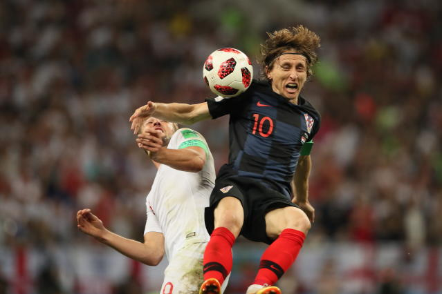 <p>Harry Kane of England and Luka Modric of Croatia during the 2018 FIFA World Cup Russia Semi Final match between England and Croatia at Luzhniki Stadium on July 11, 2018 in Moscow, Russia. (Photo by Matthew Ashton – AMA/Getty Images) </p>