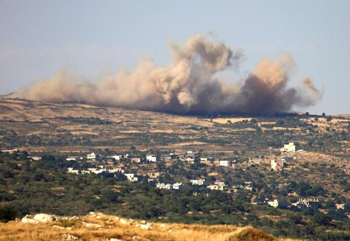 Smoke rises from the Syrian Druze village of Hader on June 16, 2015 after Al-Nusra Front reportedly launched operations against Syrian government forces (AFP Photo/Jalaa Marey)