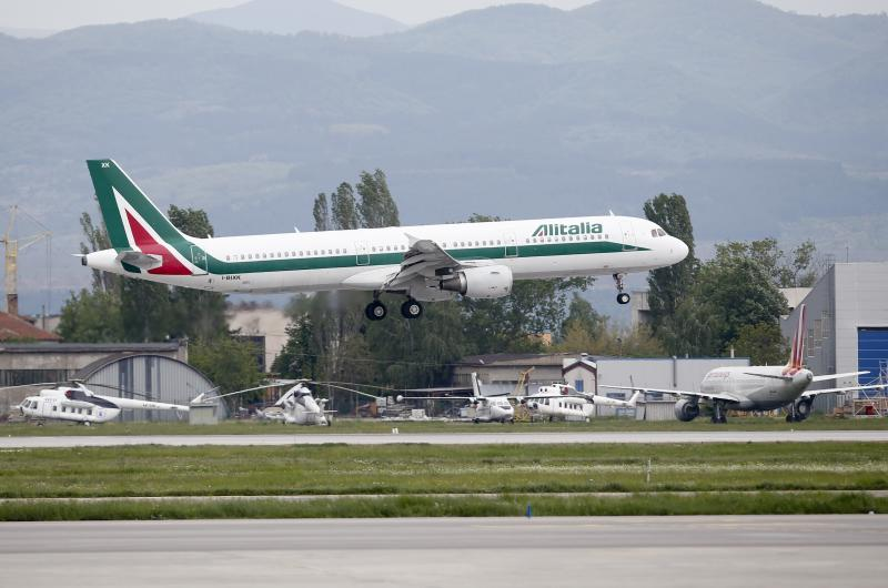 In this photo taken on Sunday, May 5, 2019, an Alitalia plane takes off from Sofia airport, Bulgaria. The Italian government is hoping the Alitalia airline will turn a new page after four private investors expressed an interest in joining the state railway, the Italian treasury and Delta Air Lines in trying once again to relaunch the struggling flagship carrier. (AP Photo/Darko Vojinovic)