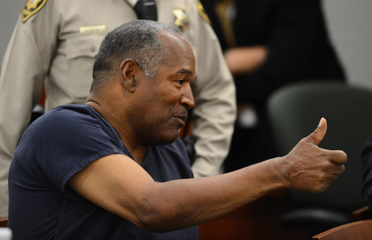 LAS VEGAS, NV - MAY 14:  O. J. Simpson speaks during a break in an evidentiary hearing in Clark County District Court on May 14, 2013 in Las Vegas, Nevada. Simpson, who is currently serving a nine-to-33-year sentence in state prison as a result of his October 2008 conviction for armed robbery and kidnapping charges, is using a writ of habeas corpus to seek a new trial, claiming he had such bad representation that his conviction should be reversed.  (Photo by Ethan Miller/Getty Images)