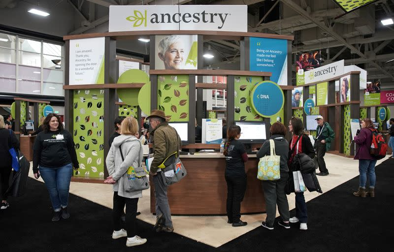 Attendees look around the Ancestry.com booth at the RootsTech annual genealogical event in Salt Lake City