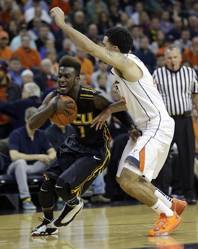 Virginia Commonwealth guard JeQuan Lewis (1) drives to the basket as Virginia guard London Perrantes (23) defends during the first half of an NCAA college basketball game in Charlottesville, Va., Tuesday, Nov. 12, 2013. (AP Photo/Steve Helber)