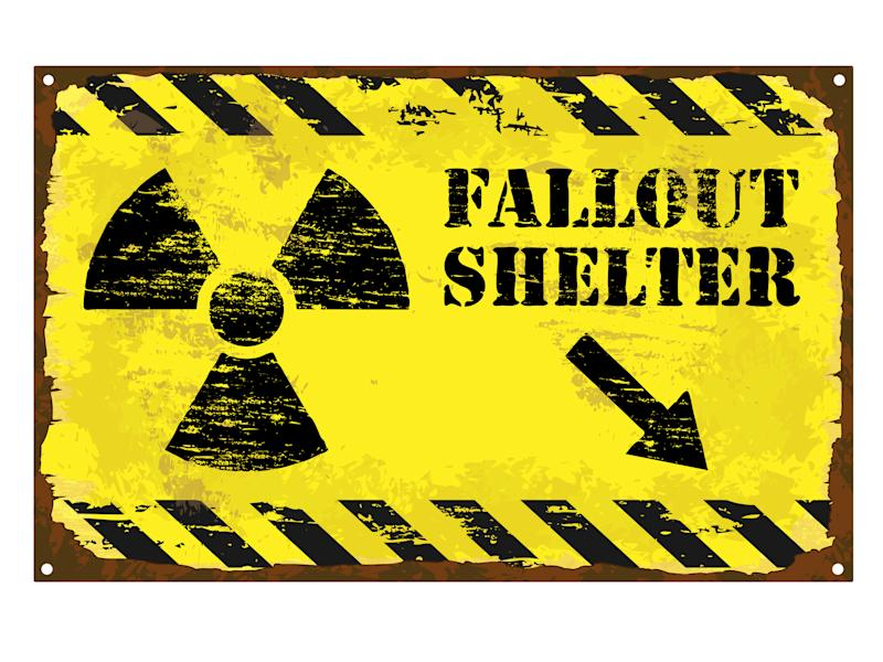Fallout shelter sign with radioactive symbol.