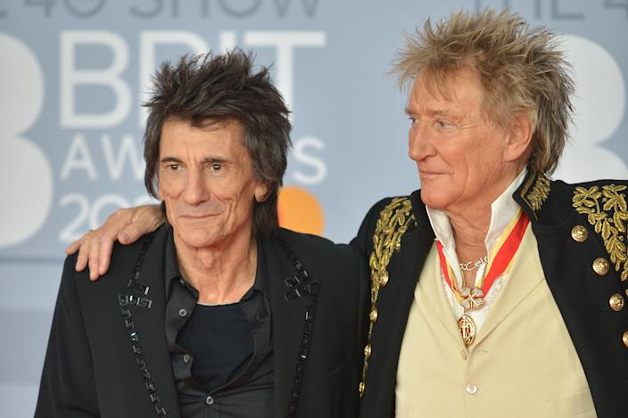 Ronnie Wood and Rod Stewart enjoyed a hug as lockdown restrictions lifted. (Photo by Jim Dyson/Redferns)