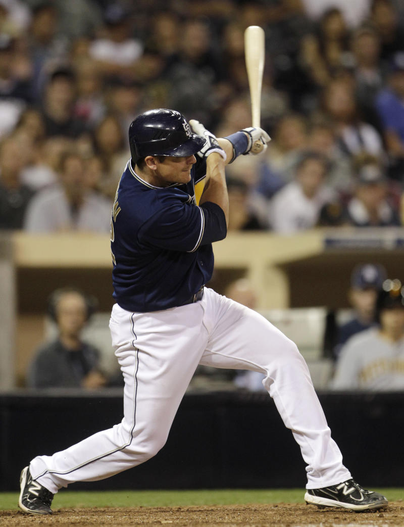 San Diego Padres' Rob Johnson follows through with his tie breaking home run swing against the Pittsburgh Pirates in the eighth  inning of a baseball game Tuesday, May 3, 2011 in San Diego. (AP Photo/Lenny Ignelzi)