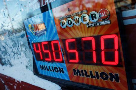 A sign advertising the Powerball lottery draw is seen outside a store in Port Washington, New York, U.S. January 5, 2018. REUTERS/Shannon Stapleton