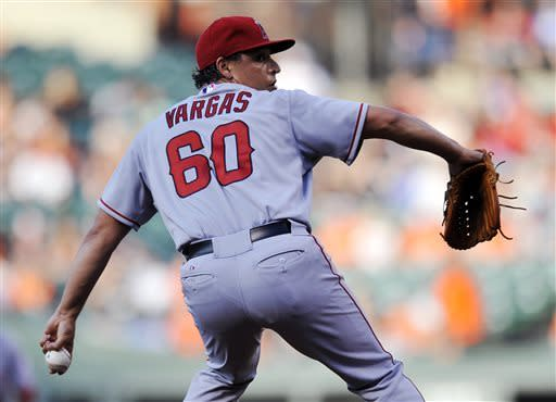 Los Angeles Angels Jason Vargas delivers against the Baltimore Orioles in the first inning of a baseball game Tuesday, June 11, 2013 in Baltimore. (AP Photo/Gail Burton)