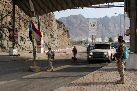 FILE PHOTO: Southern Yemeni separatists guard a checkpoint in Aden