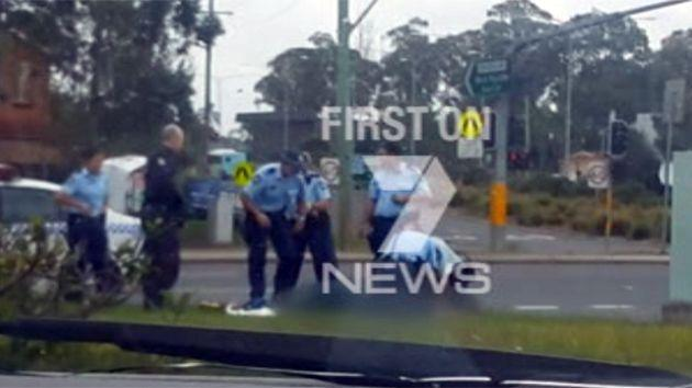 Police work to try and revive the young woman. Photo: 7News