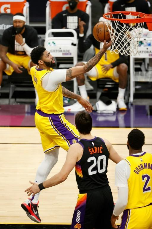 Los Angeles Lakers star Anthony Davis attempts a lay-up in the Lakers' 109-102 NBA playoff victory over the Phoenix Suns