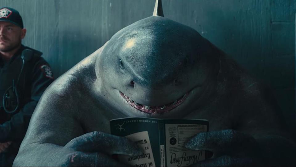 King Shark reads a book upside down in the new trailer for James Gunn's The Suicide Squad.