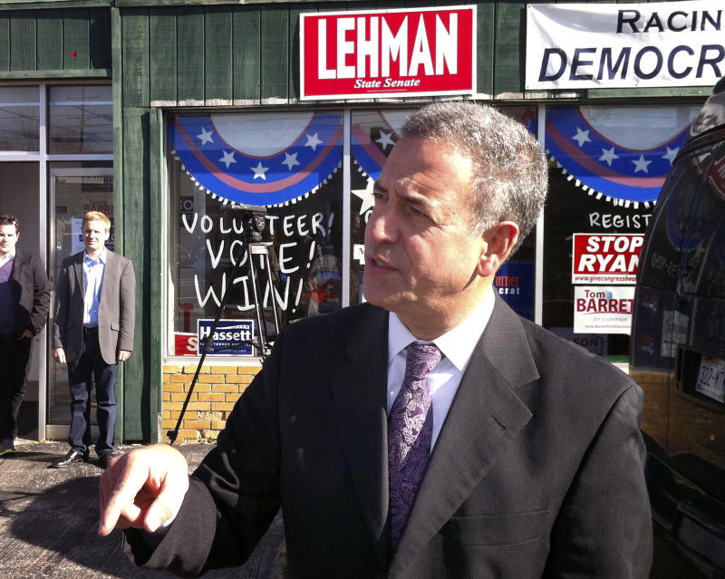 U.S. Sen. Russ Feingold, D-Wisconsin, greets supporters, Sunday, Oct. 31, 2010, during a campaign stop at the Democratic Party of Racine, Wis. County campaign headquarters in Racine, Wis. Feingold is running against Wisconsin Republican senatorial candidate Ron Johnson. (AP Photo/The Journal Times, Scott Anderson)