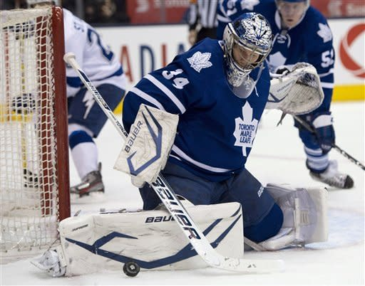Toronto Maple Leafs goaltender James Reimer makes a leg save against the Tampa Bay Lightning during the first period of an NHL hockey game in Toronto on Wednesday, March 20, 2013. (AP Photo/The Canadian Press, Frank Gunn)