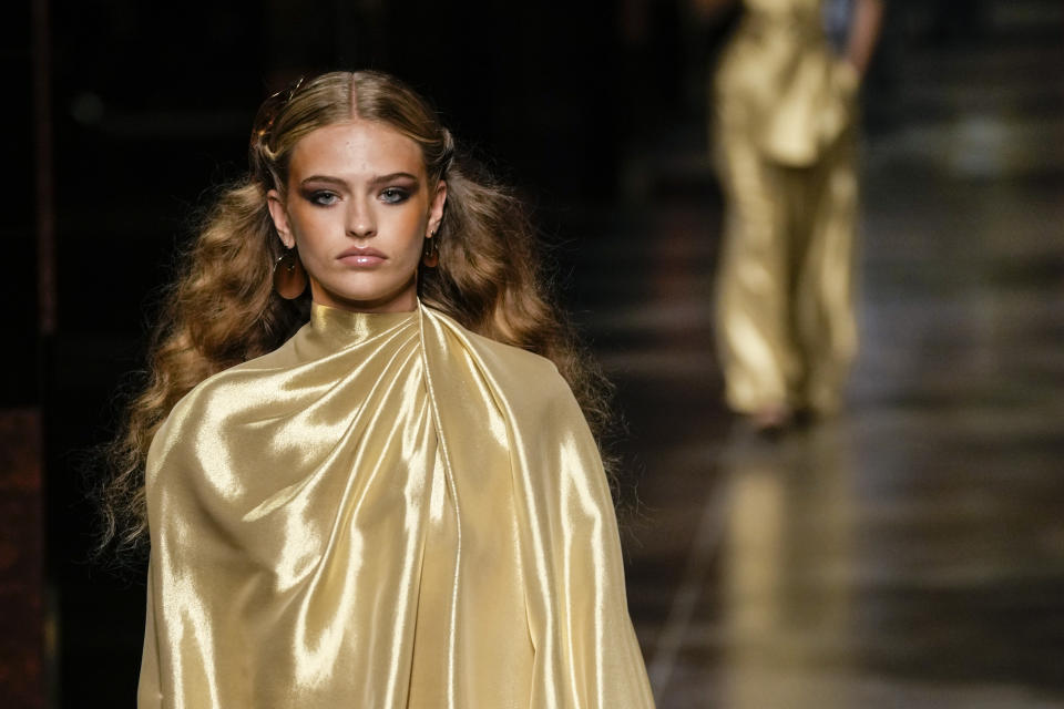 A model wears a creation for the Fendi Spring Summer 2022 collection during Milan Fashion Week, in Milan, Italy, Wednesday, Sept. 22, 2021. (AP Photo/Antonio Calanni)