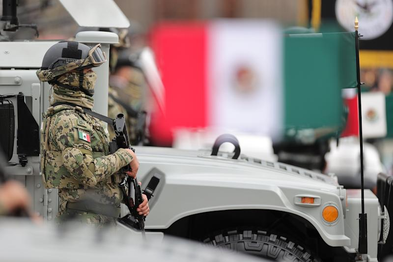 VARIOUS CITIES, MEXICO - SEPTEMBER 16: Mexican soldier pose during the Independence Day military parade at Zocalo Square on September 16, 2020 in Various Cities, Mexico. This year El Zocalo remains closed for general public due to coronavirus restrictions. Every September 16 Mexico celebrates the beginning of the revolution uprising of 1810. (Photo by Hector Vivas/Getty Images)