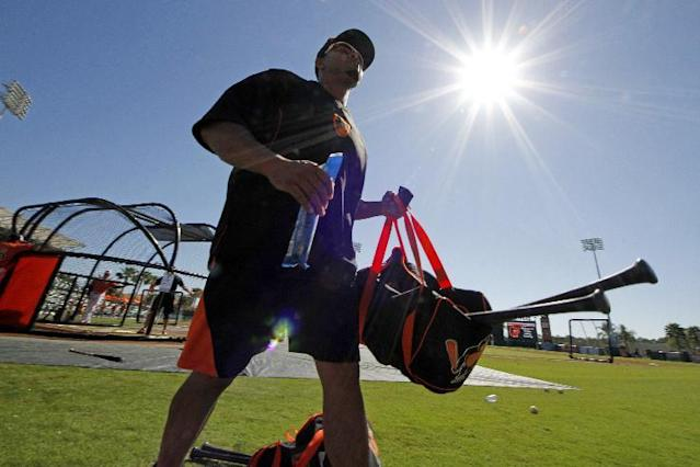Baltimore Orioles' Nelson Cruz walks to the dugout after taking batting practice before an exhibition spring training baseball game against the Toronto Blue Jays in Sarasota, Fla., Saturday, March 1, 2014. (AP Photo/Gene J. Puskar)