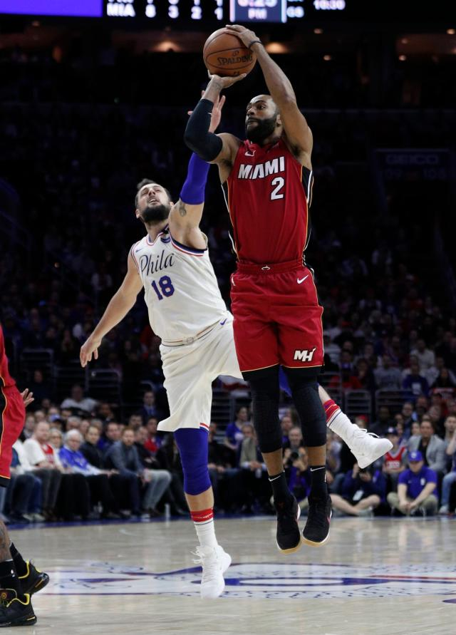 Miami Heat's Wayne Ellington, right, shoots with Philadelphia 76ers' Marco Belinelli, left, of Italy, defending during the first half in Game 2 of a first-round NBA basketball playoff series, Monday, April 16, 2018, in Philadelphia. (AP Photo/Chris Szagola)
