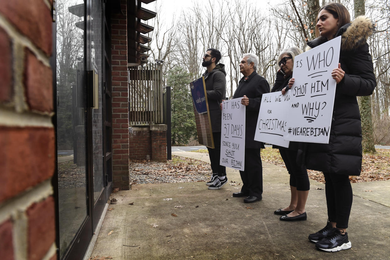 From left, Kouros Emami, the brother-in-law of Bijan Ghaisar; his parents, James and Kelly Ghaisir, and Negeen Ghaisar, his sister, stand in front of the Park Police George Washington Memorial Parkway Station trying to get someone to talk to them on Dec. 24, 2017. (Photo: Toni L. Sandys/The Washington Post via Getty Images)