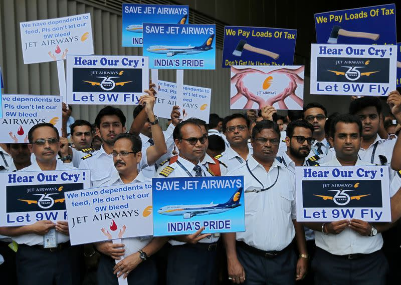 FILE PHOTO: Jet Airways employees display placards during a protest at the Chhatrapati Shivaji Maharaj International Airport in Mumbai