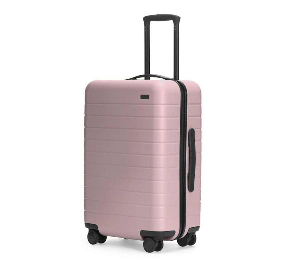 <p>We love this <span>Away The Carry-On</span> ($225) because it's light, durable, and has a phone charger in the suitcase! Everyone we know that has one is obsessed with it.</p>