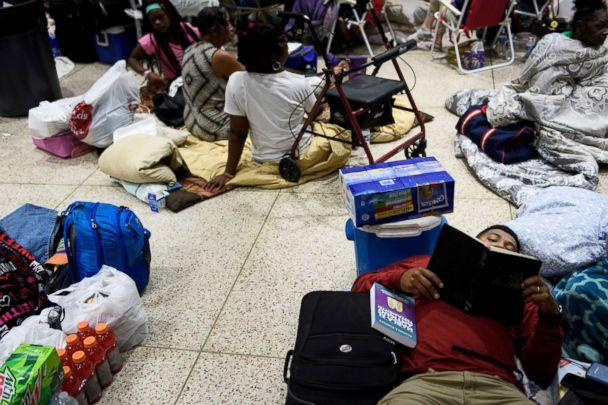 PHOTO: People seek safety in a shelter as Hurricane Michael approaches, Oct. 10, 2018, in Panama City, Fla. (Brendan Smialowski/AFP/Getty Images)