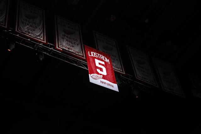 Former Detroit Red Wing Nicklas Lidstrom's No. 5 banner is raised to the rafter during the retirement of the number before an NHL hockey game between the Detroit Red Wings and Colorado Avalanche at Joe Louis Arena, Thursday, March 6, 2014, in Detroit. (AP Photo/Duane Burleson)