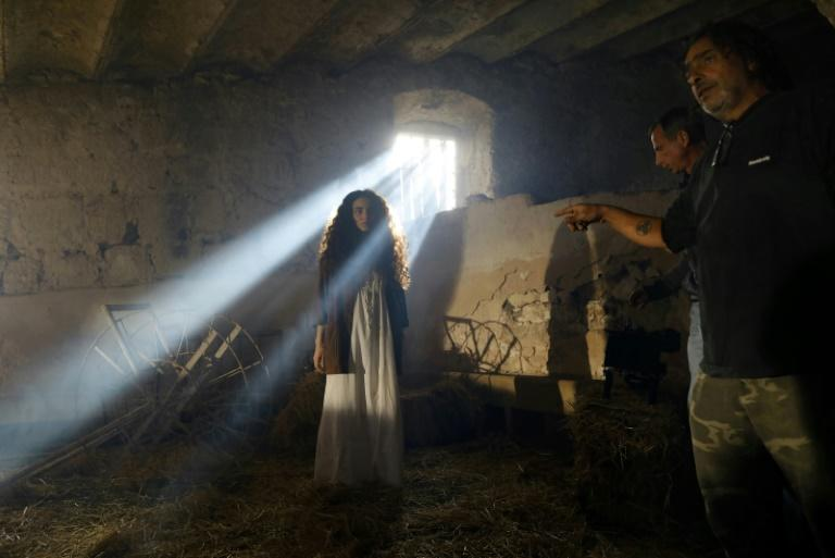 A film crew shoot a scene on the set of an Israeli television series inside the Beit Jamal monastery near the central city of Bet Shemesh, west of Jerusalem
