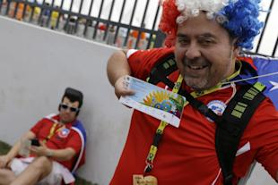 A Chilean fan shows off his ticket before Chile's Group B match against the Netherlands. (AP)
