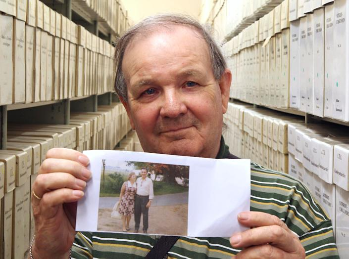 George Jaunzemis, 69, who was separated from his mother in the final days of World War II, displays a photograph showing his parents at the International Tracing Service in Bad Arolsen, Germany, on Thursday, May 19, 2011 after discovering his true identity. (Michael Probst)
