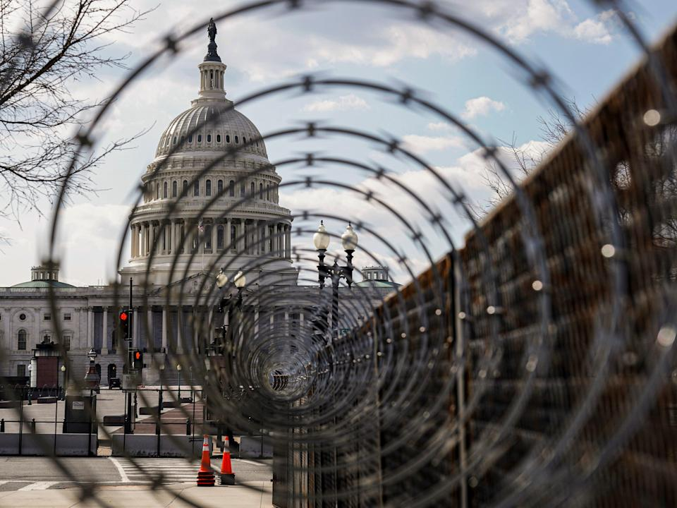 <p>The US Capitol is seen through razor wire after police warned that a militia group might try to attack the US Capitol in Washington, US, 4 March, 2021</p> (REUTERS)