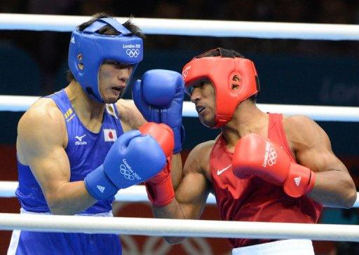 Ryota Murata of Japan (in blue) fights Esquiva Falcao of Brazil