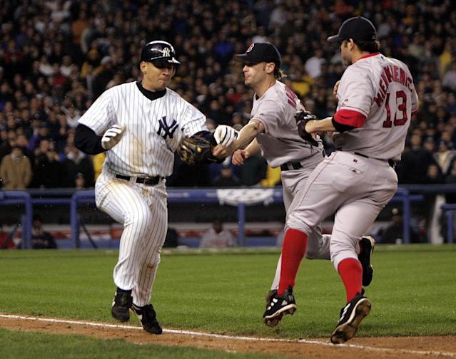 Alex Rodriguez slapped the ball out of Bronson Arroyo's glove during Game 6 of the 2004 ALCS. The duo had previously been involved in a benches-clearing brawl that July. (Photo by Barry Chin/The Boston Globe via Getty Images)