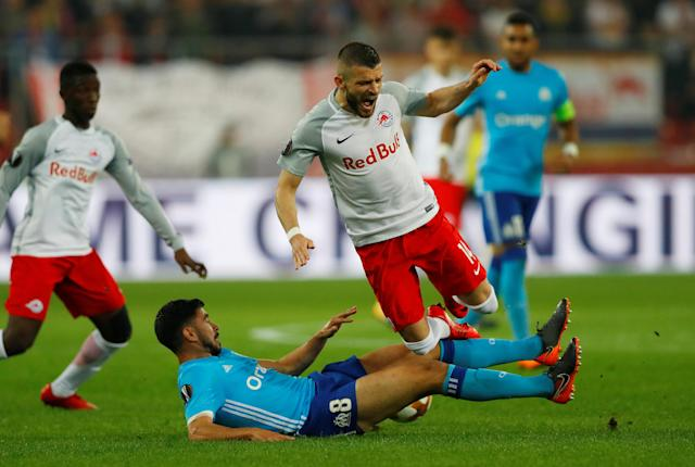 Soccer Football - Europa League Semi Final Second Leg - RB Salzburg v Olympique de Marseille - Red Bull Arena, Salzburg, Austria - May 3, 2018 Marseille's Morgan Sanson in action with RB Salzburg's Valon Berisha REUTERS/Leonhard Foeger