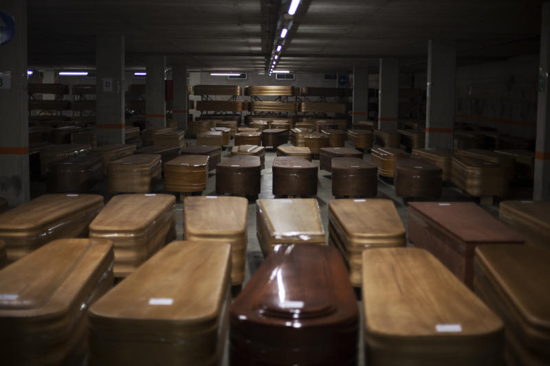 Coffins, most of them containing the bodies of COVID-19 victims, in the parking garage at the Collserola funeral parlour in Montcada i Reixac, near Barcelona. (José Colon for Yahoo News)