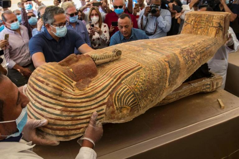 Egypt continues to unearth ancient remains - - this photograph from October 2020 shows the opening of a sarcophagus excavated by the Egyptian archaeological mission at the Saqqara necropolis near Cairo