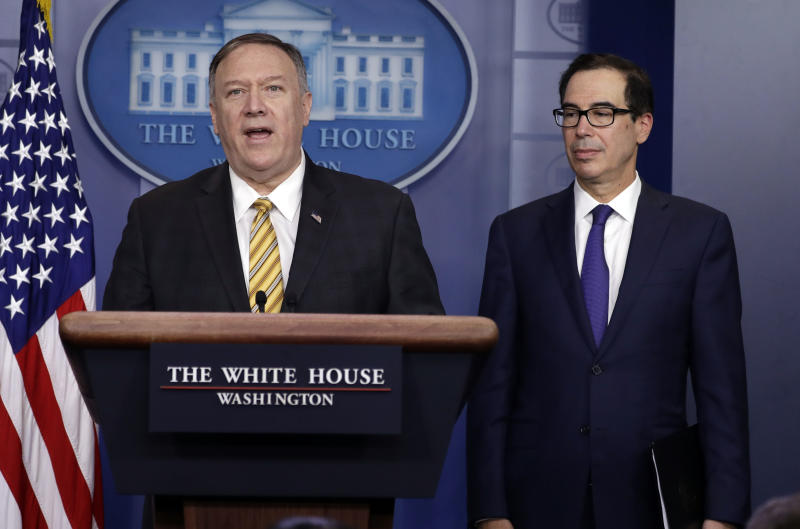 Secretary of State Mike Pompeo speaks as Treasury Secretary Steve Mnuchin listens during a briefing on terrorism financing at the White House, Tuesday, Sept. 10, 2019, in Washington. (AP Photo/Evan Vucci)