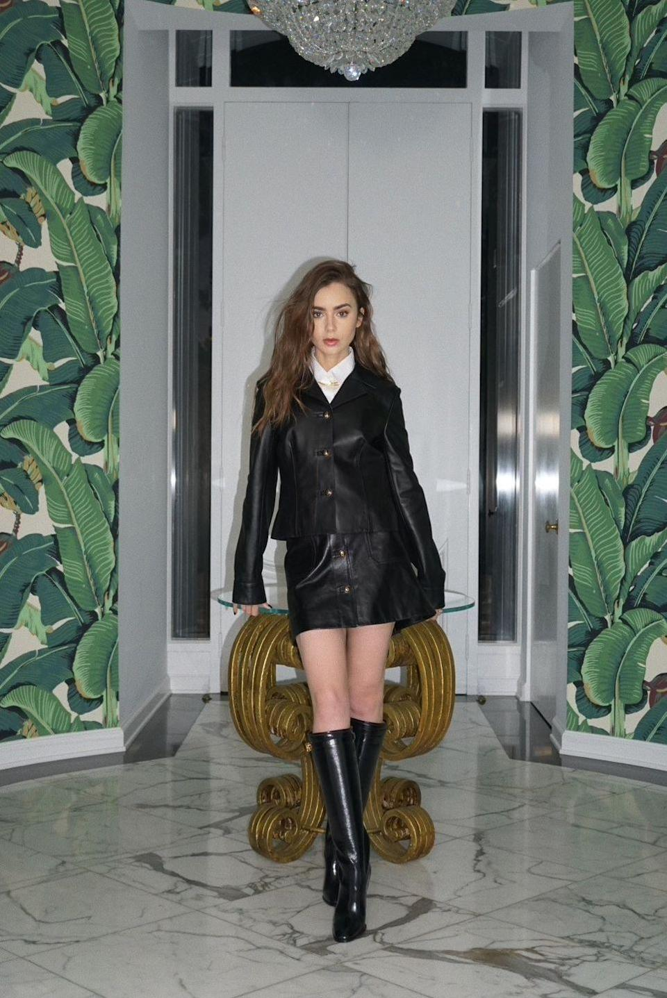 <p><strong>3 December </strong>Lily Collins wore a leather two-piece Dior look with knee-high boots. </p>