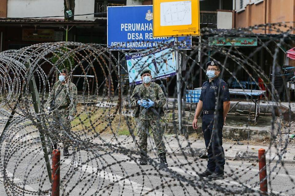 Armed Forces and police personnel patrol the vicinity of the Desa Rejang People's Housing Project in Kuala Lumpur amid the enhanced movement control order June 21, 2021. — Picture by Yusof Mat Isa