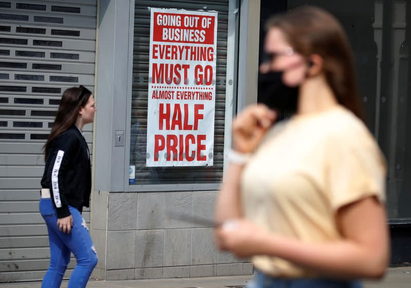 FILE PHOTO: People walk past a closed shop following the outbreak of the coronavirus disease (COVID-19) in Chester, Britain