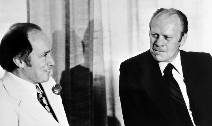 U.S. President Gerald Ford speaks with Canadian Prime Minister Pierre Trudeau during the NATO 1975 summit in Brussels. (Credit: AFP via Getty Images)