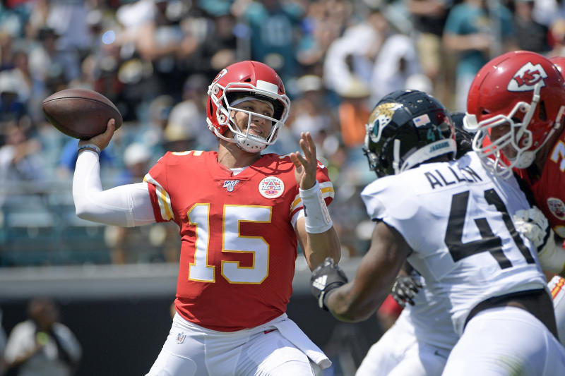 FILE - In this Sept. 8, 2019, file photo, Kansas City Chiefs quarterback Patrick Mahomes (15) throws a pass as he is pressured by Jacksonville Jaguars defensive end Josh Allen during the first half of an NFL football game in Jacksonville, Fla. Mahomes Mahomes is the reigning league MVP. (AP Photo/Phelan M. Ebenhack, File)