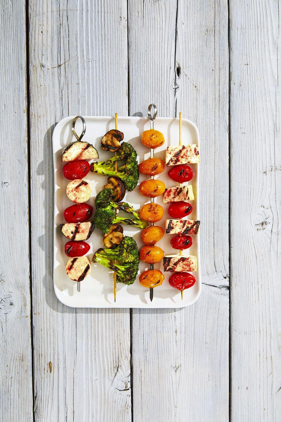 """<p>For an eye-catching veggie platter, coordinate each sewer by color. </p><p><span><a href=""""https://www.goodhousekeeping.com/food-recipes/a39273/rainbow-veggie-kabobs-recipe/"""" rel=""""nofollow noopener"""" target=""""_blank"""" data-ylk=""""slk:Get the recipe for Rainbow Veggie Kabobs »"""" class=""""link rapid-noclick-resp"""">Get the recipe for Rainbow Veggie Kabobs »</a></span><br></p>"""