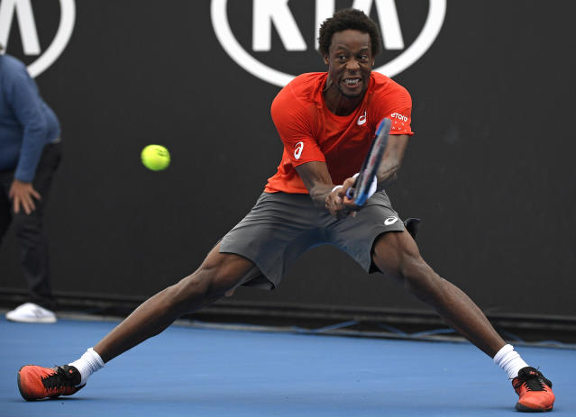 France's Gael Monfils makes a backhand return to United States' Taylor Fritz during their second round match at the Australian Open tennis championships in Melbourne, Australia, Wednesday, Jan. 16, 2019. (AP Photo/Andy Brownbill)