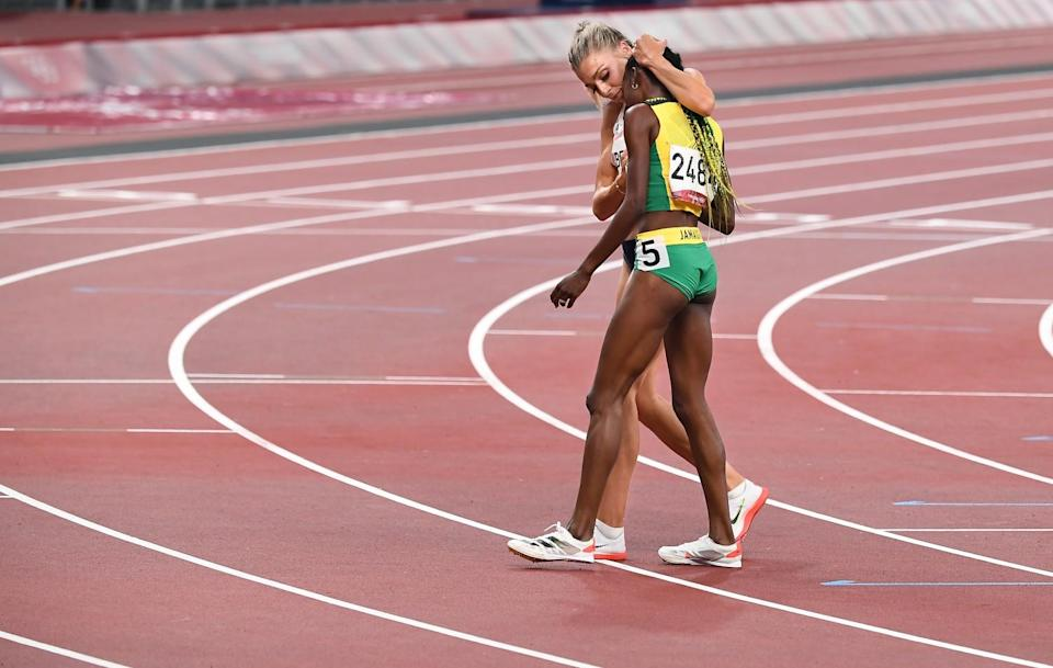 Britain's Alexandra Bell hugs Jamaica's Natoya Goule, foreground, after the 800-meter final.
